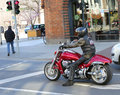 Motorcycle rider waiting at red light Royalty Free Stock Photo