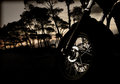 Motorcycle wheel on sunset Royalty Free Stock Photo