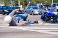 Motorcycle wreck at a busy intersection Stock Photos