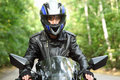 Motorcyclist goes on road, front view, closeup Royalty Free Stock Photo