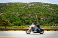 Motorcyclist on mountain road Royalty Free Stock Photo
