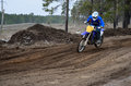 Motorcyclist rides motocross track on knolls Royalty Free Stock Photos