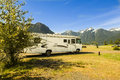 Motorhome in canada side view front of mountains Royalty Free Stock Image