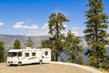 Motorhome in canada side view front of the okanagan lake and mountains Stock Photo