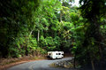 Motorhome driving drive through Daintree National Park Queenslan Royalty Free Stock Photo