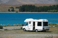 Motorhome at the lake pure white parked lakes edge in tekapo new zealand Stock Photos
