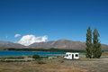 Motorhome at lake pure white parked the s edge in tekapo new zealand Royalty Free Stock Images