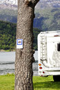 Motorhome parked alongside banning notice Stock Image