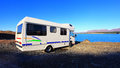 Motorhome or rv parked at lake pukaki in south island of new zealand on a clear spring morning with blue sky Stock Images