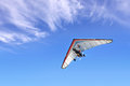 Motorized hang glider the in the blue sky Royalty Free Stock Photos
