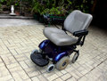 Motorized wheel chair specially manufactured for handicapped persons Stock Images