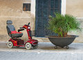Motorized wheelchair car. Royalty Free Stock Photo
