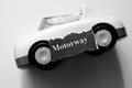Motorway automotive industry headlines and a car toy Royalty Free Stock Photo