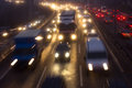 Motorway crowded freeway in misty weather Stock Images
