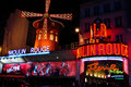 The moulin rouge famous cabaret and theater paris france september people queue for tickets in front of on september in Stock Image