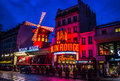 The Moulin Rouge by night. Royalty Free Stock Photo