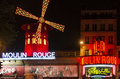 Moulin rouge paris the by night in france is a famous cabaret built in locating in the red light district Royalty Free Stock Photo