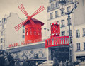 The moulin rouge with retro vintage instagram style filter effe effect is a famous cabaret built in locating in paris Stock Image