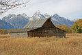 Moulton barn with trees alley and Teton Range Royalty Free Stock Photo