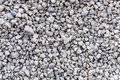 Mound of granite gravel, stones, crushed stone close-up. Rough seamless texture, construction material background