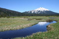 Mount bachelor from sparks lake flood plain reflects in the marshy of in the central oregon cascades Stock Photography