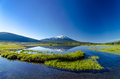 Mount bachelor and sparks lake a wide angle view of being perfectly reflected in a near bend oregon Stock Image