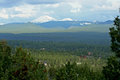 Mount bachelor and tumalo mountain suburbs are intermixed within evergreen forest in this shot from overturf butte on the west Stock Photography