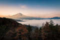 Mount Fuji enshrouded in clouds from lake kawaguchi,  Yamanashi, Japan Royalty Free Stock Photo