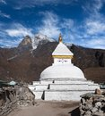 Mount Khumbila and buddhist white stupa in Khumjung, Nepal Royalty Free Stock Photo