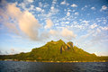 Mount otemanu bora bora french polynesia south pacific beautiful cloud formations over the peaks of the extinct volcanos of pahia Stock Image