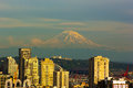 Mount Rainier and Seattle buildings at sunset hours. Royalty Free Stock Photo