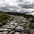Mount snowdon path dramatic depiction of the dry stone hikers leading to the summit of under a stormy sky sonwdonia north wales Stock Images