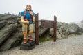 Mount washington summit nh july hiker statue at of landmark nh on a foggy day Stock Photography