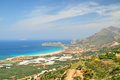 Mountain above a sandy beach on crete and blue sea Stock Photo