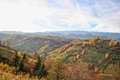 The mountain autumn landscape with colorful forest rural village Stock Photos
