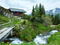 Mountain bettmeralp village summer cloudy view with small brook switzerland Stock Photography