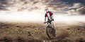 Mountain bike cyclist riding single track above sunset valley Stock Photography