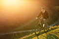 Mountain Bike cyclist riding single track at sunrise, healthy life Royalty Free Stock Photo