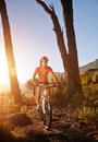 Mountain bike cyclist riding single track sunrise healthy lifestyle active athlete doing sport Stock Photos