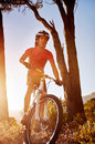 Mountain bike cyclist riding single track sunrise healthy lifestyle active athlete doing sport Royalty Free Stock Images