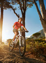 Mountain bike cyclist riding single track sunrise healthy lifestyle active athlete doing sport Stock Photo