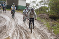 Mountain bike riders in the rain in the andes zamora region ecuador july and mud mountains on july governments ecuador are Stock Image
