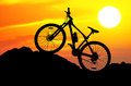 Mountain bike silhouette of the at sunset Stock Image