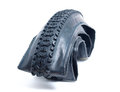 Mountain bike tire deflated on white background Royalty Free Stock Image