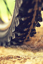Mountain bike wheel close up with dirt dust particles Royalty Free Stock Photo
