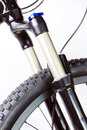 Mountain bike wheel and shock fork Royalty Free Stock Photo