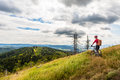 Mountain biker cycling riding in woods and mountains Royalty Free Stock Photo