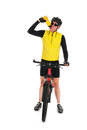 Mountain biker drinking water in studio Royalty Free Stock Images
