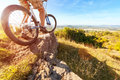 Mountain biker looking at downhill dirt track Royalty Free Stock Photo