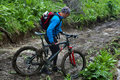 Mountain biker and mud terrain Royalty Free Stock Photos